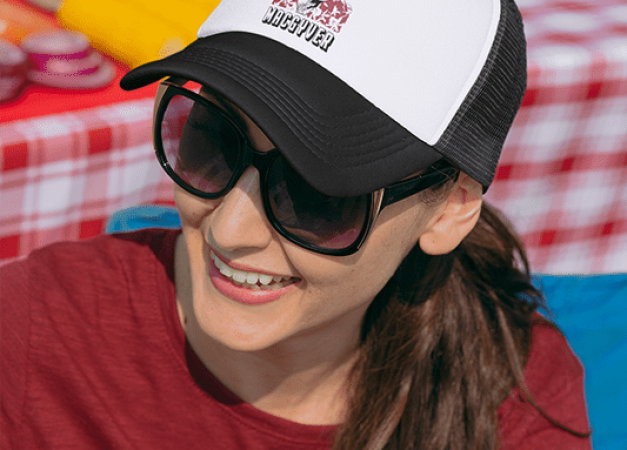 mockup-of-a-woman-with-a-trucker-hat-at-a-tailgate-party-29874